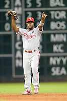 Philadelphia Phillies shortstop Jimmy Rollins #11 points during the Major League Baseball game against the Houston Astros at Minute Maid Park in Houston, Texas on September 13, 2011. Houston defeated Philadelphia 5-2.  (Andrew Woolley/Four Seam Images)