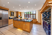 BNPS.co.uk (01202 558833)<br /> Pic: Hamptons/BNPS<br /> <br /> Pictured: The spacious kitchen.<br /> <br /> An incredible Arts and Crafts country house with its own vineyard is on the market for offers over £7m.<br /> <br /> The Grade II listed St Joseph's Hall is a striking 111-year-old property that was home to the Bishop of Arundel for 40 years.<br /> <br /> It has a wealth of period features, an indoor swimming pool and seven acres of vineyard with mostly Chardonnay grapes, which the owners sell to a local winery.<br /> <br /> The house in Storrington, West Sussex, has 17 acres of land with beautiful views over the South Downs.
