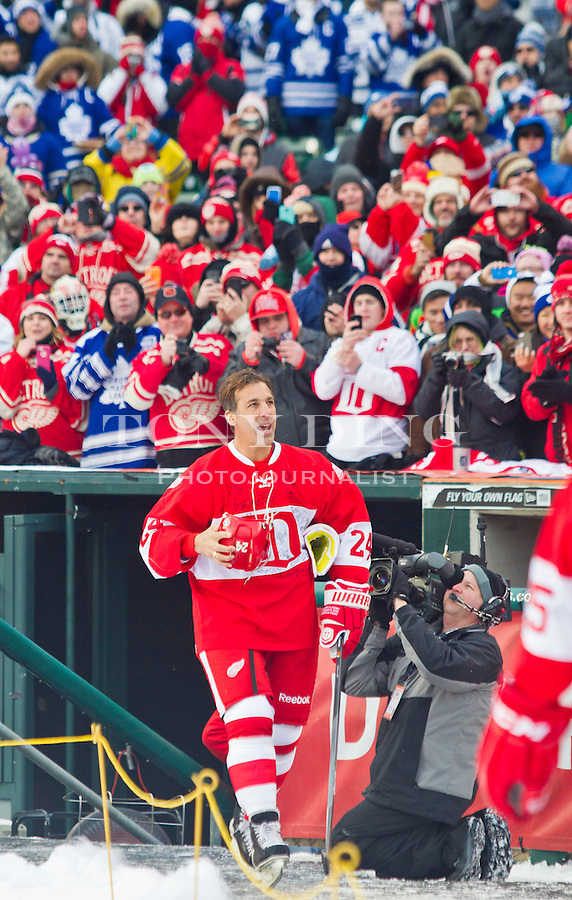 31 December 2013: Former Detroit Red Wings defenseman Chris Chelios (24) is introduced before the Toronto Maple Leafs v Detroit Red Wings Alumni Showdown hockey game, at Comerica Park, in Detroit, MI.
