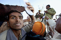 India. Uttar Pradesh state. Allahabad. Maha Kumbh Mela. A crowd of Indian Hindu devotees, who have lost their parents or relatives, are writing their names on a piece of paper and give them to the police for a public announcement by loudspeakers on the day of Maghi Purnina Snan. The Kumbh Mela, believed to be the largest religious gathering is held every 12 years on the banks of the 'Sangam'- the confluence of the holy rivers Ganga, Yamuna and the mythical Saraswati. The belief is that bathing and taking a holy dip will wash and free one from all the past sins, get salvation and paves the way for Moksha (meaning liberation from the cycle of Life, Death and Rebirth). The Maha (great) Kumbh Mela, which comes after 12 Purna Kumbh Mela, or 144 years, is always held at Allahabad. Uttar Pradesh (abbreviated U.P.) is a state located in northern India. 25.02.13 © 2013 Didier Ruef