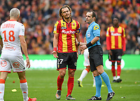 20191102 – Lens , France : Guillaume Gillet (27) of Lens pictured with Fabien Lemoine (18) of Lorient and referee Benoit MILLOT during a French Ligue 2 soccer game between Racing Club de Lens and FC Lorient , a football game on the 13th matchday in the French second league, on saturday 2 nd of November 2019 at the Stade Bollaert Delelis in Lens , France . PHOTO SPORTPIX.BE | DAVID CATRY