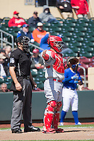 Home plate umpire Ryan Goodman and Ed Easley (4) of the Memphis Redbirds who calls for the pitch out during the game against the Omaha Storm Chasers in Pacific Coast League action at Werner Park on April 22, 2015 in Papillion, Nebraska.  (Stephen Smith/Four Seam Images)