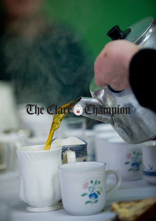 The tea is poured hot and strong at the Feakle Parish Afternoon Tea Social in the local Hall. Photograph by John Kelly.