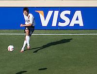 Sacha Kjestan eyes his cross. The USA defeated China, 4-1, in an international friendly at Spartan Stadium, San Jose, CA on June 2, 2007.