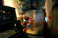 """Richard J. Concepcion, a.k.a. Rapid T. Rabbit, drinks milk in a Mickey Mouse glass at his apartment in Queens, New York, as he edits video for his cable access television show """"Rapid T. Rabbit and Friends.""""   Furries are a group of people who identify themselves not as being human but as a walking, talking animal.  For some the lifestyle is complete, animal traits reach into every aspect of life from mundane trips to a grocery store to sexual fantasies.  For others, involvement in the furry fandom is limited to public performances and meet-and-greets."""