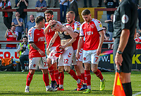 Ash Huner of Fleetwood Town (22) celebrates with team mates after he scores his team's first goal during the Sky Bet League 1 match between Fleetwood Town and Peterborough at Highbury Stadium, Fleetwood, England on 19 April 2019. Photo by Stefan Willoughby.