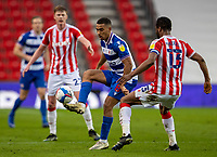 6th February 2021; Bet365 Stadium, Stoke, Staffordshire, England; English Football League Championship Football, Stoke City versus Reading; Andy Rinomhota of Reading passes the ball away from John Obi Mikel of Stoke City