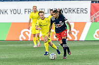 FOXBOROUGH, MA - OCTOBER 3: Gustavo Bou #7 of New England Revolution looks to pass as Dax McCarty #6 of Nashville SC defends during a game between Nashville SC and New England Revolution at Gillette Stadium on October 3, 2020 in Foxborough, Massachusetts.
