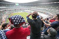 MEXICO CITY, MEXICO - June 11, 2017:  USA fans react to the USA team's near miss at the World Cup Qualifier match against Mexico at Azteca Stadium.