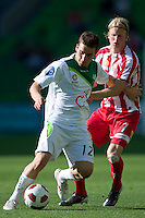 MELBOURNE, AUSTRALIA - January 2:  Panagiotis Nikas of the Fury and Rutger Worm of the Heart compete for the ball during the round 21 A-League match between Melbourne Heart and North Queensland Fury at AAMI Park on January 2, 2011 in Melbourne, Australia. (Photo by Sydney Low / Asterisk Images)