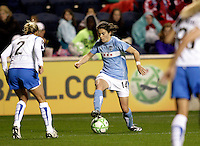Chicago Red Stars forward Karen Carney (14) makes a move against Boston Breakers defender Heather Mitts (2).  Carney scored on the play.  The Chicago Red Stars defeated the Boston Breakers 4-0 at Toyota Park in Bridgeview, IL on April 25, 2009.