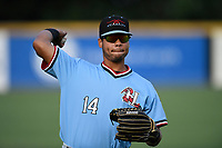Right fielder Tyler Ratliff (14) of the Hickory Crawdads warms up before a game against the Greenville Drive on Monday, August 20, 2018, at Fluor Field at the West End in Greenville, South Carolina. Hickory won, 11-2. (Tom Priddy/Four Seam Images)