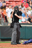 Umpire Nick Lentz makes a call during a game between the Pawtucket Red Sox  and Buffalo Bisons on August 26, 2014 at Coca-Cola Field in Buffalo, New  York.  Buffalo defeated Pawtucket 15-2.  (Mike Janes/Four Seam Images)