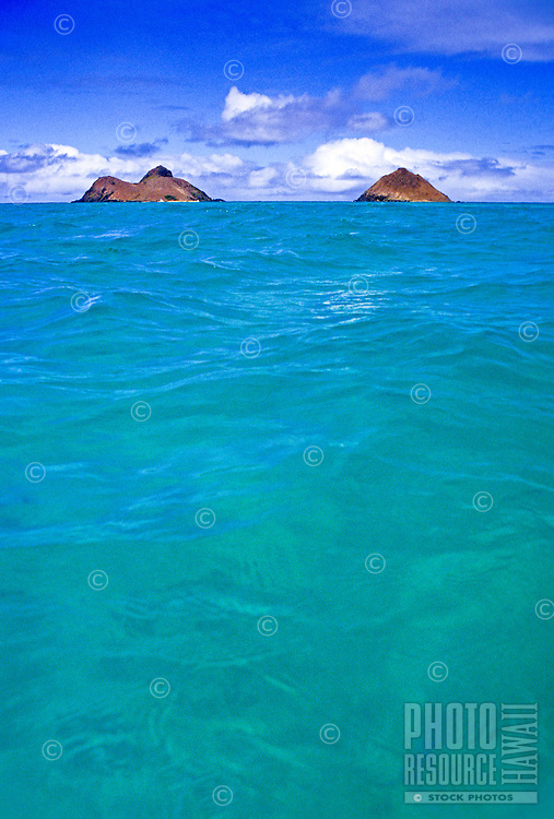 A clear shot of the famous turquoise water leading to the Mokulua islands off Lanikai Beach on windward Oahu.
