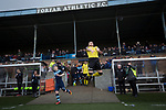 Forfar Athletic 1 Edinburgh City 2, 02/02/2017. Station Park, SPFL League 2. Visiting defender Jordan Caddow leaps into the air as the teams come on to the pitch at Station Park, Forfar before the SPFL League 2 fixture between Forfar Athletic and Edinburgh City. It was the club's sixth and final meeting of City's inaugural season since promotion from the Lowland League the previous season. City came from behind to win this match 2-1, watched by a crowd of 446. Photo by Colin McPherson.
