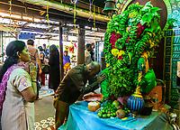 Worshipers Pray at Hanuman Shrine, Sree Veera Hanuman Hindu Temple, Kuala Lumpur, Malaysia.