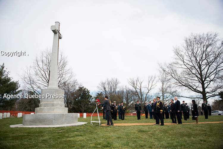 Prime Minister of Canada Justin Trudeau and his wife Sophie lay a wreath at the Canadian Cross of Sacrifice at Arlington National Cemetery, March 11, 2016, in Arlington, VA. Trudeau laid a wreath at the Tomb of the Unknown Soldier and the Canadian Cross of Sacrifice while at the cemetery. (U.S. Army photo by Rachel Larue/Arlington National Cemetery/released).