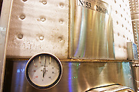a tank with a temperature control shielding cooled with sub zero liquid so that there is frost ice on the outside of the tank. thermometer showing one degree above zero centigrade Bodega Del Fin Del Mundo - The End of the World - Neuquen, Patagonia, Argentina, South America