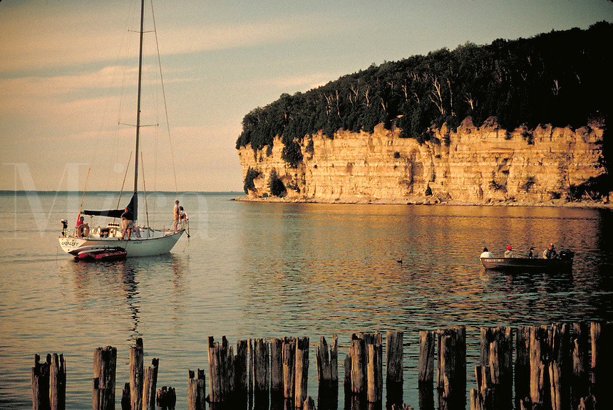 Snail Harbor with chalk cliffs along Lake Michigan shore, boats. Fayette Historical State Park Michigan USA.
