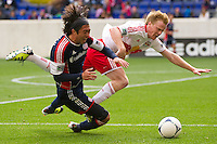 Lee Nguyen (24) of the New England Revolution and Dax McCarty (11) of the New York Red Bulls get tangled up. The New York Red Bulls defeated the New England Revolution 1-0 during a Major League Soccer (MLS) match at Red Bull Arena in Harrison, NJ, on April 28, 2012.