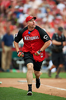Cincinnati Reds great Sean Casey runs to first base during the All-Star Legends and Celebrity Softball Game on July 12, 2015 at Great American Ball Park in Cincinnati, Ohio.  (Mike Janes/Four Seam Images)