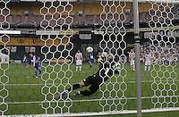 Guatemala forward Carlos Ruiz (20) scores against Paraguay goalkeeper Justo VIllar (1) from a penalty kick.  Guatemala tied Paraguay 3-3 in a international friendly match at RFK Stadium, Wednesday August 15, 2012.