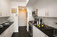 White kitchen with black worktop
