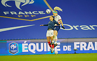 LE HAVRE, FRANCE - APRIL 13: Julie Ertz #8 of the United States leaps higher than Léa Khelifi #10 of France during a game between France and USWNT at Stade Oceane on April 13, 2021 in Le Havre, France.