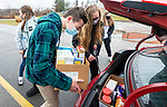 WATERTOWN, CT-011621JS03- Members of the Watertown High School Interact Club, including Giacole Rinaldi and club president Kara Davidson, load boxes of donated food into a vehicle for delivery during a food drive Saturday at the high school. All food, personal items and donations will benefit  Safe Haven of Waterbury. The club, which usually holds a pajama collection drive, held the food drive due to COVID restriction on clothing donations. <br /> Jim Shannon Republican-American