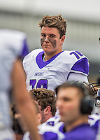 8 October 2016: Amherst College Purple & White Offensive Lineman Brendan Coleman, a First Year from Phoenix, AZ, is attentive to coaching on the sidelines during a game against the Middlebury College Panthers at Alumni Stadium in Middlebury, Vermont. The Panthers edged out the Purple & While 27-26. Mandatory Credit: Ed Wolfstein Photo *** RAW (NEF) Image File Available ***