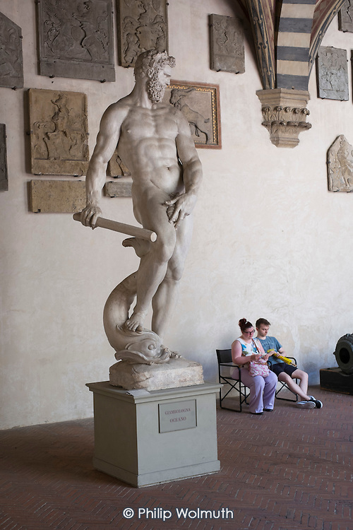 Tourists and sculptures in the Bargello Gallery, Florency, Italy