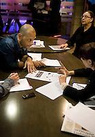 Executive Producer Carlos Van Meek (left) takes morning conference at news channel Al Jazeera English in Doha.