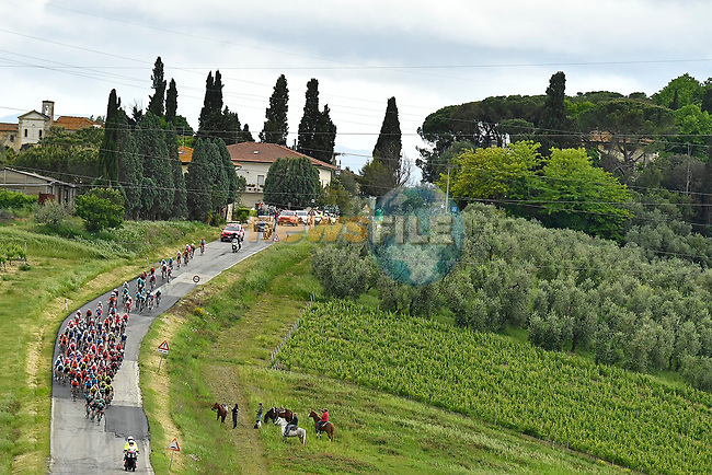 The rain has stopped and sunshine appears for the peloton during Stage 2 of the 2019 Giro d'Italia, running 205km from Bologna to Fucecchio, Italy. 12th May 2019<br /> Picture: Fabio Ferrari/LaPresse | Cyclefile<br /> <br /> All photos usage must carry mandatory copyright credit (© Cyclefile | Fabio Ferrari/LaPresse)
