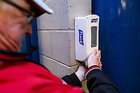 12th March 2020, Ibrox Stadiu, Glasgow, Scotland; Europa League football, Glasgow Rangers versus Bayer Leverkusen;  a fan uses the hand sanitizer upon entry to the standium