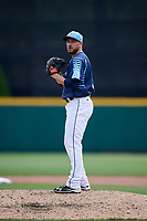 Columbus Clippers relief pitcher Cole Sulser (50) gets ready to deliver a pitch during a game against the Gwinnett Stripers on May 17, 2018 at Huntington Park in Columbus, Ohio.  Gwinnett defeated Columbus 6-0.  (Mike Janes/Four Seam Images)