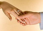 Male and female hand with engagement ring