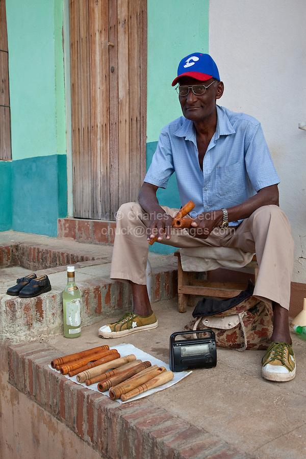 Cuba, Trinidad.  Afro-Cuban Vendor of Wooden Percussion Instruments.