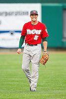 Fort Wayne TinCaps left fielder Corey Adamson (5) warms up between innings of the Midwest League game against the Lansing Lugnuts at Cooley Law School Stadium on June 5, 2013 in Lansing, Michigan.  The TinCaps defeated the Lugnuts 8-5.  (Brian Westerholt/Four Seam Images)