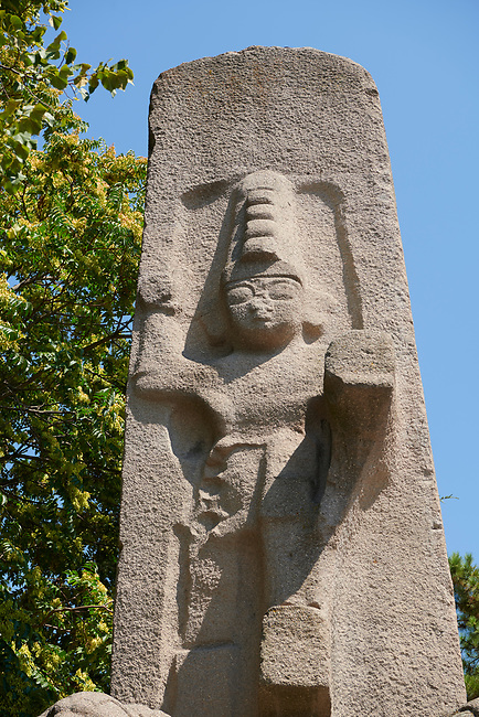 Close up of the Hittite Fasillar Monument, finished replica of 13th century BC original. Anatolian Civilisations Museum, Ankara, Turkey<br /> <br /> The original is an unfinished monumental stele that is situated fiat on the back on a slope at the immediate vicinity of the village Fasillar within the Konya province, Beysehir. This is an exact replica of the original that was made of trachyte igneous rock. This represents the origin& that was cast into the mould of the same dimensions and colour. <br /> <br /> The height from the toes to the top of the lions is 7,40 meters. There is also a socket that is 80 cm. Long inserted into the basement. The Hittite monument dates from the end of 13th century BC There appears the great God higher than 4 meters stepping on the smaller mountain God that is accompanied by the lions on.