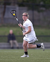 Boston College attacker Kelly McNelis (3) brings the ball forward. Boston College defeated University of Vermont, 15-9, at Newton Campus Field, April 4, 2012.