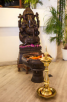 India, Dehradun.  Shrine to the Hindu God Ganesh, Riding a Mouse, in a Hotel Lobby.
