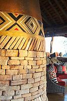 A seating area on a covered terrace at Singita Pamushana Lodge, Malilongwe Trust, Zimbabwe.