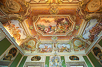 The Room of Summer - Frescoes on the vaulted ceiling depict the myth of Proserpine who, during the summer, rises from the dead to her mother Ceres, painted by Fedele Fischetti. Above the doors paintings by Giovan Battista de Rossi depict the Allegories of the liberal arts alternated with representations of the Rivers of the Kingdom of Naples. The Kings of Naples Royal Palace of Caserta, Italy. A UNESCO World Heritage Site