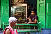 A sweet shop in the narrow alleys of the ancient city of Varanasi in Uttar Pradesh, India. Photograph: Sanjit Das/Panos