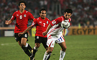 Costa Rica's Diego Madrigal (11) keeps the ball away from Egypt's Ahmed Hegazy (6), left, and Aly Mohamed (7) during the FIFA Under 20 World Cup Round of 16 match between Egypt and Costa Rica at the Cairo International Stadium on October 06, 2009 in Cairo, Egypt.