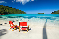 Red beach chairs<br /> Maho Bay<br /> Virgin Islands National Park<br /> St. John<br /> US Virgin Islands