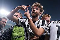 Manuel Locatelli of Juventus FC celebrates with team mates after scoring the victory goal of 0-1 during the Serie A 2021/2022 football match between Torino FC and Juventus FC at Stadio Olimpico Grande Torino in Turin (Italy), October 2nd, 2021. Photo Federico Tardito / Insidefoto