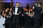 © Joel Goodman - 07973 332324 . 05/03/2015 .  Midland Hotel , Manchester , UK . Winners Bott and Co Solicitors , walk up to the stage to collect their award . Small Law Firm of the Year . The Manchester Legal Awards 2015 . Photo credit : Joel Goodman