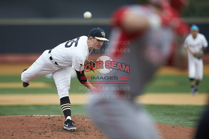 Wake Forest Demon Deacons starting pitcher Morgan McSweeney (35) delivers a pitch to the plate against the Sacred Heart Pioneers at David F. Couch Ballpark on February 15, 2019 in  Winston-Salem, North Carolina.  The Demon Deacons defeated the Pioneers 14-1. (Brian Westerholt/Four Seam Images)