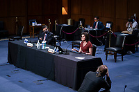 Saikrishna Prakash, a professor at the University of Virginia Law School, left, and Laura Wolk, the first blind woman to clerk at the Supreme Court and a former student of Barrett's at Notre Dame Law School, testify during the Senate Judiciary Committee confirmation hearing of Amy Coney Barrett, U.S. President Donald Trump's nominee for associate justice of the U.S. Supreme Court, on Capitol Hill in Washington, D.C., U.S., on Thursday, Oct. 15, 2020. <br /> Credit: Sarah Silbiger / Pool via CNP /MediaPunch